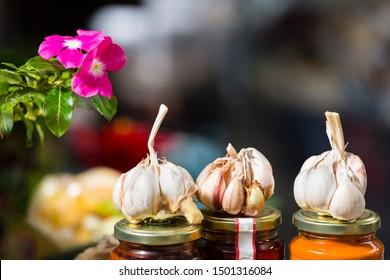Garlic and flower display in the Plaza de Mercado market in Santa Cruz de La Palma, Spain.