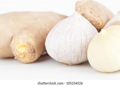 Garlic and ginger closeup on white