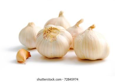Garlic groups on white background, isolated