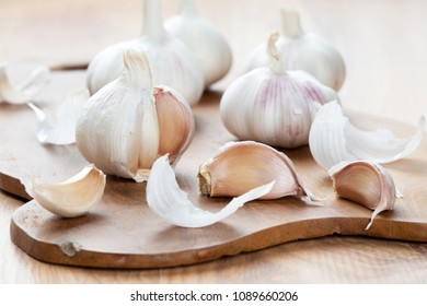 Garlic heads on wooden board