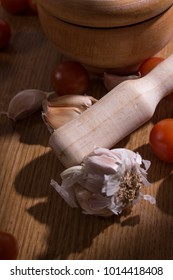 garlic with mortar and tomatoes