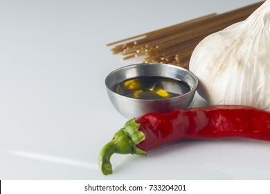 Garlic oil and chili spaghetti ingredient on white background