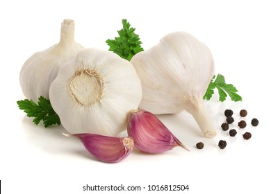 garlic with parsley leaf and peppercorn isolated on white background