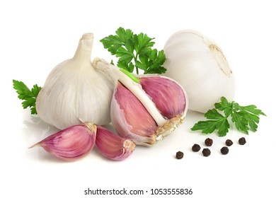 garlic with parsley leaf and peppercorn isolated on white background.