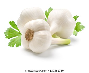 Garlic and parsley leaves isolated on white background.