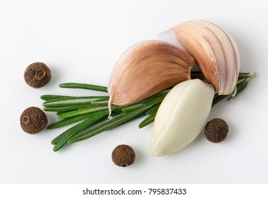 Garlic with rosemary, black pepper isolated on white background. Isolated garlic
