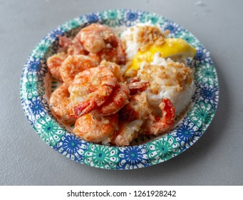 Garlic shrimps served with white rice and lemon slice - famous dish of the North Shore of Oahu, Hawaii
