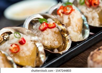 Garlic, small abalone, seafood cuisine