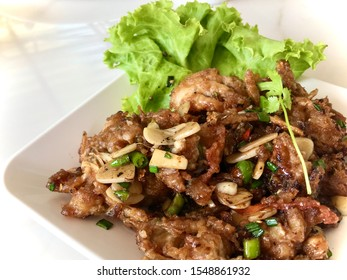Garlic Soft-shell Crab on White Plate on the  table.The Fried soft shell crab with garlic.