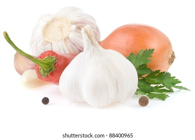 garlic and vegetables with food spices isolated on white background