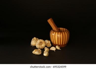 Garlics on the black background