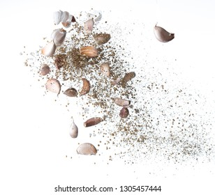 Garlic,various spices, pepper and salt splash or explosion flying in the air isolated on white,Stop motion