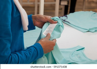 at a garment factory quality control check for defects