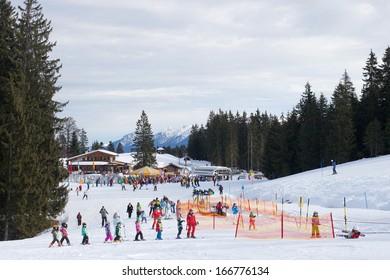 GARMISCH, GERMANY - JANUARY 08: Children and adults on slope of ski resort, Garmisch-Partenkirchen, Germany on January 08, 2012. Garmisch classic is the biggest ski region in Germany.