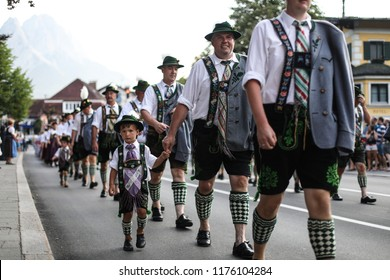 "Garmisch-Partenkirchen, Bavaria, Germany - August 4, 2018: The ""Heimatwochen"" (local weeks) celebrate Bavarian culture with processions, national costume groups and dancing in traditional clothing."