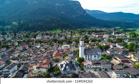 Garmisch-Partenkirchen, Germany - August 4, 2018: An aerial view of downtown Garmisch, a town in the Bavarian Alps. The Parish Church of St. Martin stands in the center.