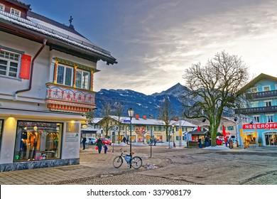GARMISCH-PARTENKIRCHEN, GERMANY - JANUARY 06, 2015: View of the street in Garmisch-Partenkirchen, an idyllic mountain resort in the valleys of the Bavarian Alps beneath the towering Zugspitze peak