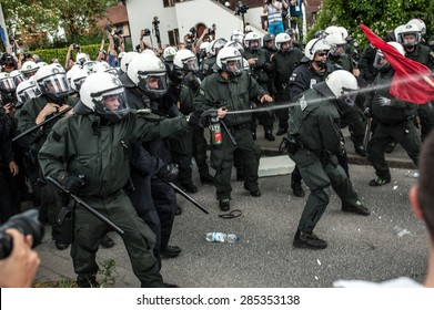 GARMISCH-PARTENKIRCHEN, GERMANY - JUNE 06: Police officers scuffle with anti-G7 protesters. G7 leaders will meet at nearby Schloss Elmau on June 7-8