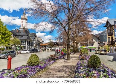 Garmisch-partenkirchen, Germany - May 2, 2017: View of the street in Garmisch-Partenkirchen in Bavarian Alps.