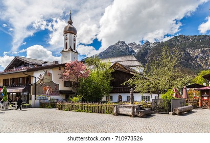 Garmisch-partenkirchen, Germany - May 2, 2017: Garmisch-Partenkirchen is a small cozy town with painted houses in medieval style in Bavarian Alps. Germany