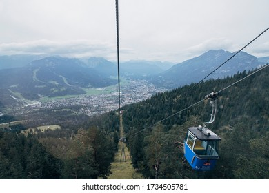 Garmisch-Partenkirchen, Germany - September 22nd 2015: Looking down towards Garmisch from inside one of the cars on the Wankbahn funicular riding up to the Wank Mountain