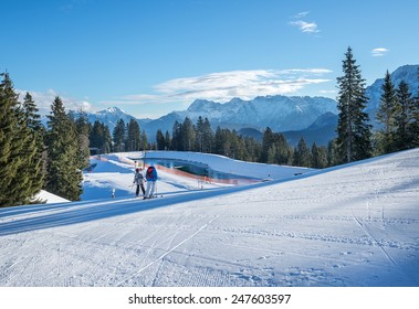 Garmisch-Partenkirchen town in Bavarian Alps, Germany, 07.01.2015. Mountain skiing slopes skiing at Hausberg top near Garmisch-Partenkirchen town in Bavarian Alps in Germany on a clear winter day