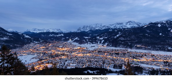 Garmisch-Partenkirchen in winter with fog and mountains in the background at sunset, Bavaria, Germany