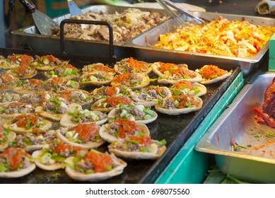 Garnachas in fair of Jocotenango, Guatemala, tortillas of corn fried with meat and fresh vegetables.
