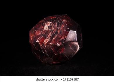 garnet crystal stone in front of black
