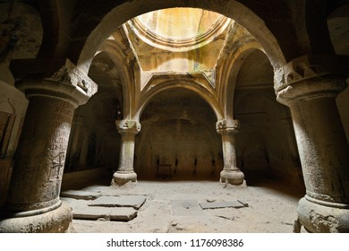 GARNI, ARMENIA - 24 AUGUST 2018: Geghard monastery near Yerevan  is a medieval monastery in the Kotayk province of Armenia, being partially carved out of the adjacent mountain