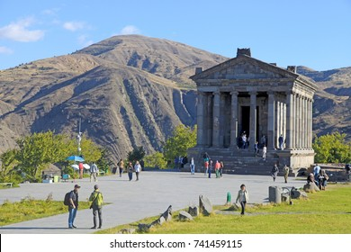 GARNI, ARMENIA - OCTOBER 1, 2016: Tourists at Ancient hellenistic Garni pagan Temple in Armenia