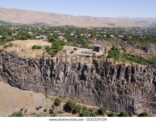 garni temple up in rocks, backside is village Garni