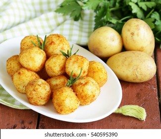 Garnish potato balls with herbs and spices