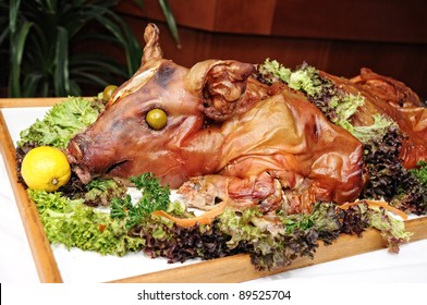 garnished with roasted pig on a tray, food