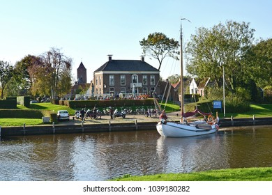 GARNWERD, GRONINGEN/NETHERLANDS – OCTOBER 15, 2017: The Reitdiep with café Hammingh, the former ferry house, in Garnwerd