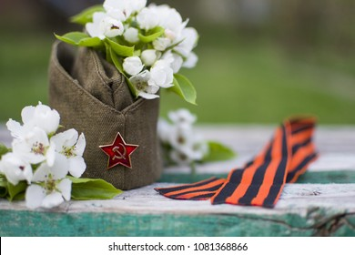 garrison cap, apple blossom, George ribbon are symbol of Victory day