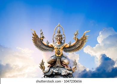 Garuda statue isolated on sunset sky background