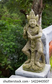 Garuda or watchman statue in front of the bridge railing for save crossing