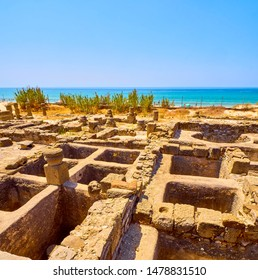 Garum sauce and Salting factories of Baelo Claudia Archaeological Site, with the Bolonia Beach in the background. Tarifa, Cadiz. Andalusia, Spain.