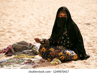 Garyan /  Libya - 04 06 2016 : A Muslim woman in burqa showing her jewelry