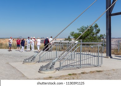 Garzweiler lignite mine, Germany - June 29 2018: People visiting viewpoint with skywalk at Garzweiler brown coal mine in Germany