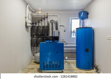 Gas Boiler room in a private house.  Heating system with hot water thermal storage tank