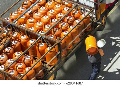 gas bottles with butane in truck with  worker for delivery