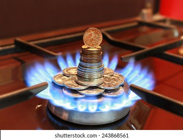 Gas burner with a blue flame and Russian coins
