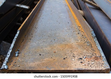 Gas burner cut on steel channel. The use of steel channel to strengthen the foundation of the house in a construction site.