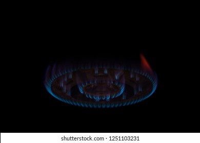 Gas burner flame at gas stove on dark background,selective focus