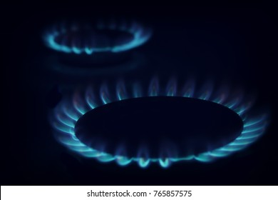 Gas burning in the burner over black background