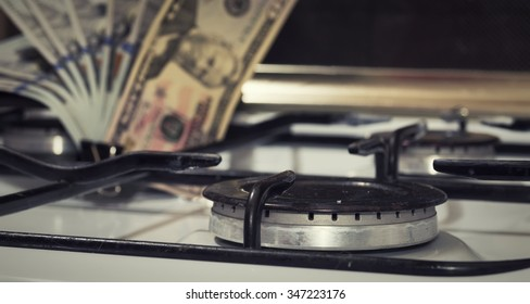 gas burning from a kitchen gas stove and the background dollars
