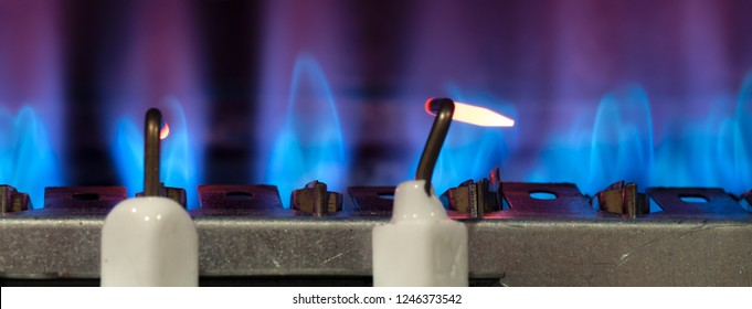 Gas burns in modern water heater. Сloseup. Selective focus.