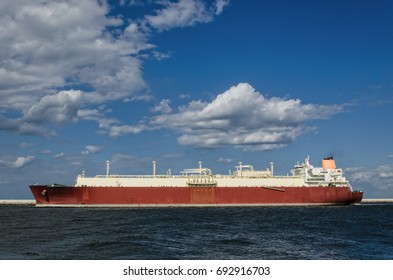 GAS CARRIER - A big ship sailing out of the harbor